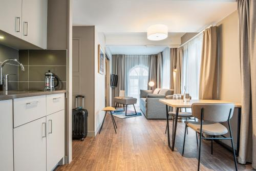 A kitchen or kitchenette at Aparthotel Adagio Lille Centre Grand Place