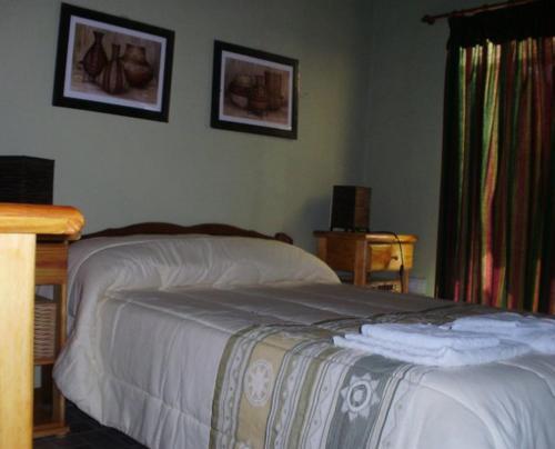 Una cama o camas en una habitación de Rocío de Luz