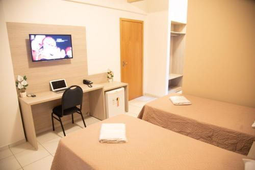 A bed or beds in a room at Getúllio Hotel