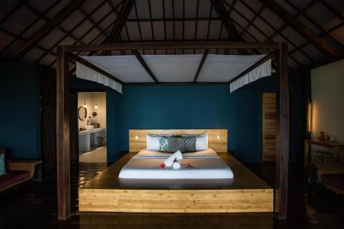 A bed or beds in a room at Kalinaw Resort