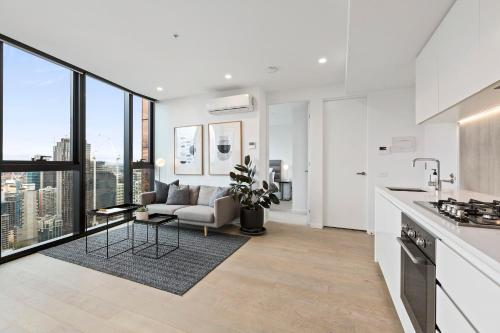A kitchen or kitchenette at Luxuria Apartments - Avant