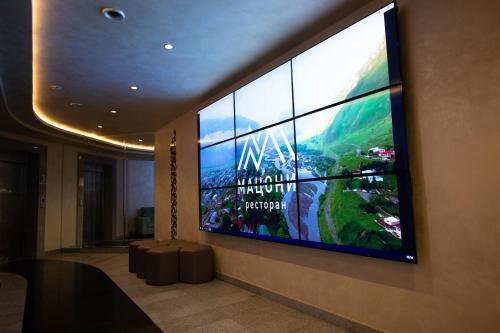 Télévision ou salle de divertissement dans l'établissement Hotel Imereti