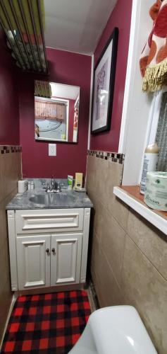 A bathroom at Tulsi's Cozy Studio