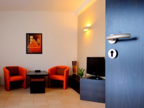 Telewizja i/lub zestaw kina domowego w obiekcie Puenta Aparthotel