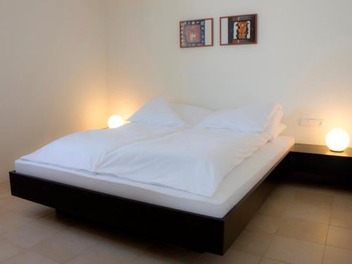 Łóżko lub łóżka w pokoju w obiekcie Puenta Aparthotel