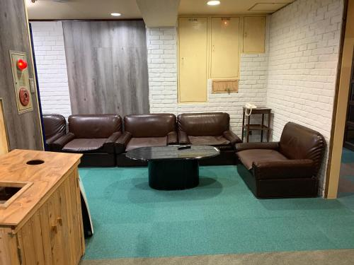 A seating area at Capsule Hotel 310