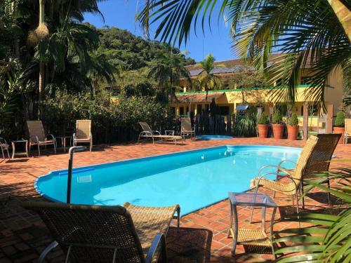 The swimming pool at or near Pousada Portal do Vigolo