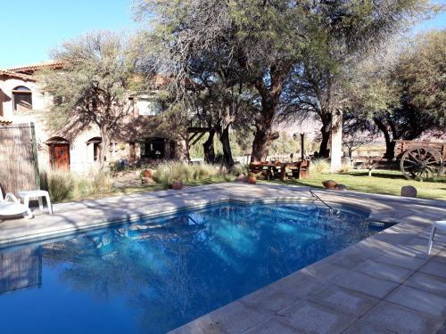 The swimming pool at or near La Casa De La Bodega - Wine Boutique Hotel