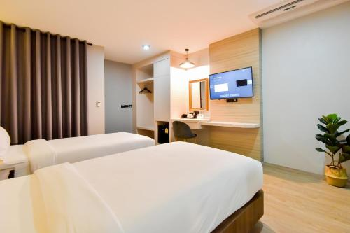 A bed or beds in a room at U Rip Resort