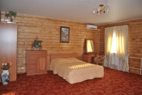 Кровать или кровати в номере Санаторий Подмосковье УДП РФ