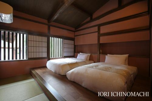 A bed or beds in a room at Iori Stay Hida