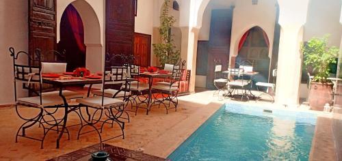 The swimming pool at or near Riad Safia