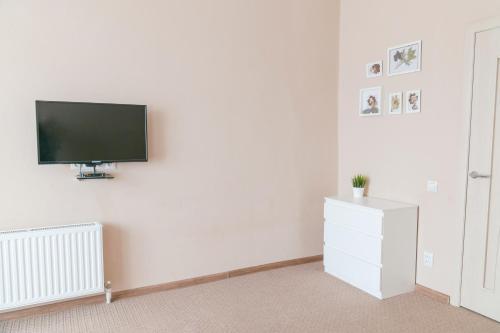 Телевизор и/или развлекательный центр в Апартаменты с видом на горы