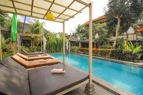 The swimming pool at or near Pondok Kutuh Guest House