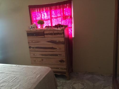 A bed or beds in a room at Kool Vybz