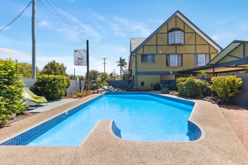 The swimming pool at or near Coastal Bay Motel