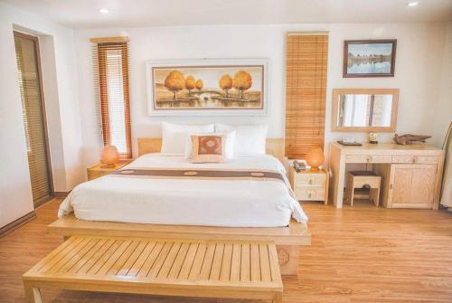 A bed or beds in a room at Thảo Viên Resort