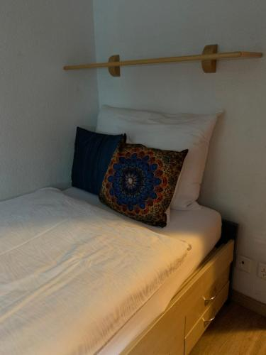 A bed or beds in a room at Mazot Zermatt