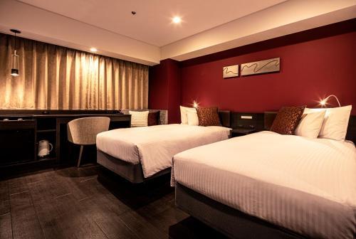 A bed or beds in a room at Agora Place Osaka Namba