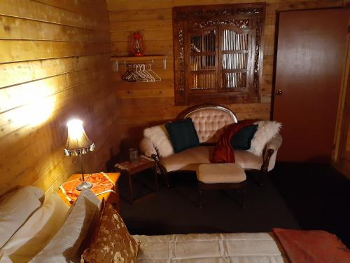 A seating area at Cabin Retreat Homestead Entire home 2 night minimum