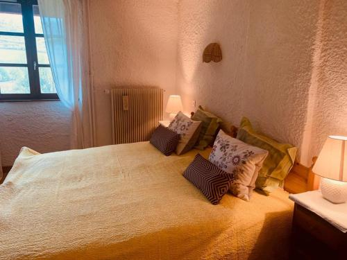 A bed or beds in a room at Le Castel Blanc