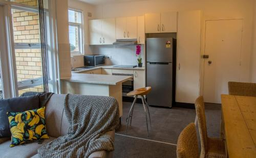 A kitchen or kitchenette at St Valentines Apartments Mosman