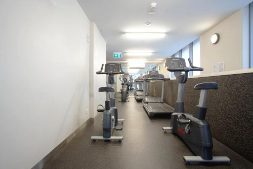 The fitness center and/or fitness facilities at BHB Explore CBD Doorsteps #Free Carpark, Wine, Wifi