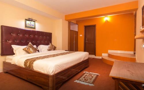 A bed or beds in a room at Kalej New vally