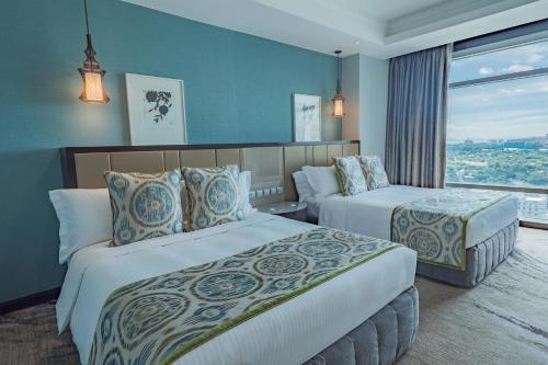 A bed or beds in a room at Ascott Makati