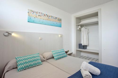 Ein Bett oder Betten in einem Zimmer der Unterkunft Club Sa Coma