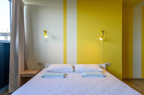 A bed or beds in a room at Hostel Terminal Adler