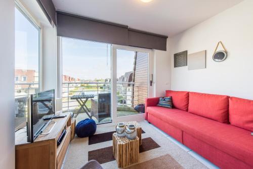 Ein Sitzbereich in der Unterkunft Modern Apartment with Terrace & public Pool