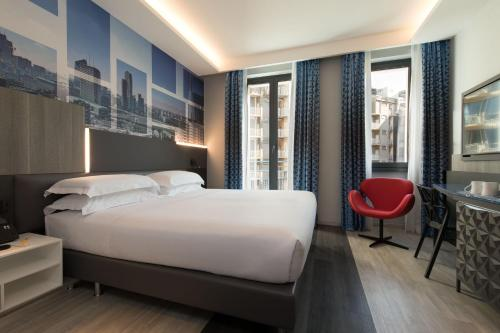A bed or beds in a room at iQ Hotel Milano