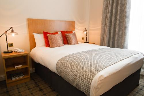 A bed or beds in a room at Bannatyne Hotel Darlington