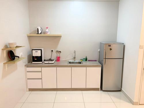 A kitchen or kitchenette at Arte S Family Stay @ USM Georgetown Penang