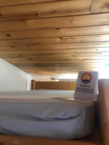 A bed or beds in a room at Estes Park Adventure Hostel