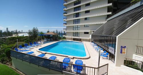 The swimming pool at or near Gemini Court Holiday Apartments