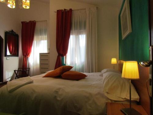 Кровать или кровати в номере Hotel Monterosso Alto