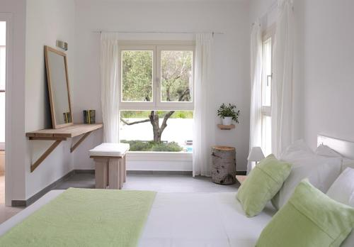 Кровать или кровати в номере Olivemare