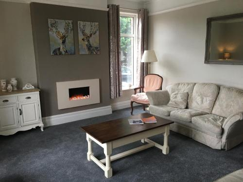 A seating area at Holly Trees Hotel