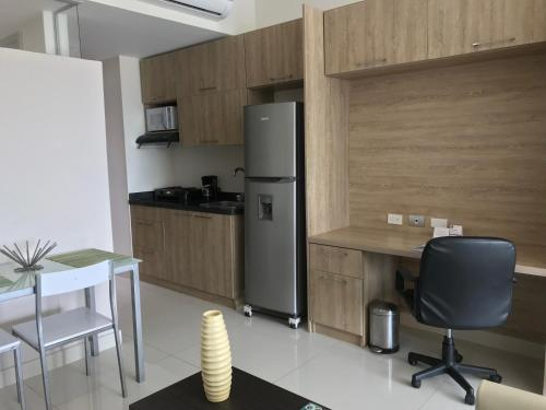 A kitchen or kitchenette at GHL Collection Barranquilla Hotel