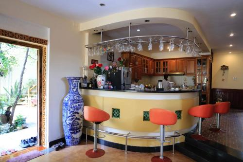 The lounge or bar area at The HillSide Homestay Hue