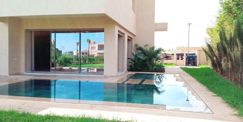 The swimming pool at or near Dar Rekik Argan golf resort Villa