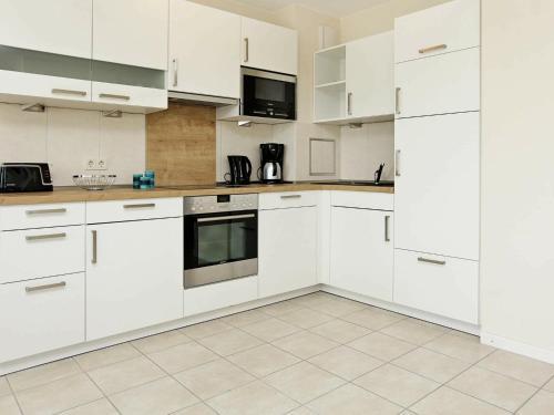 Kuchyň nebo kuchyňský kout v ubytování One-Bedroom Holiday home in Großenbrode 4