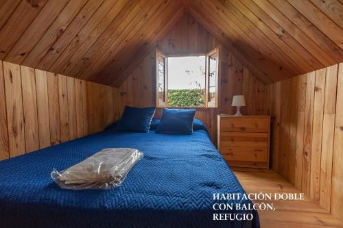 A bed or beds in a room at Camping El Palmar