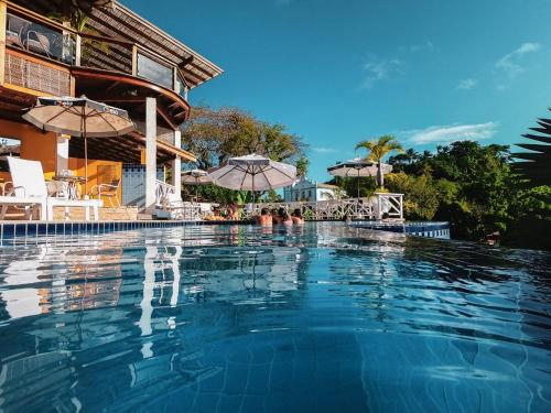 The swimming pool at or near Passárgada Pousada e Restaurante