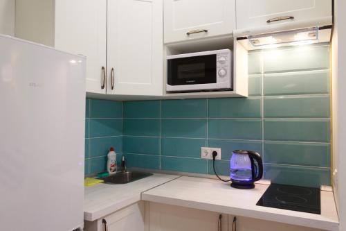 Кухня или мини-кухня в Студия у Снежкома, Крокус Экспо и метро Мякинино