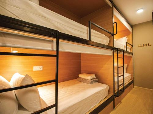 A bunk bed or bunk beds in a room at Hexa Hotel & Backpackers Bukit Bintang
