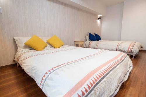A bed or beds in a room at Cookie House M