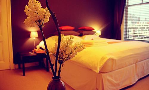 Een bed of bedden in een kamer bij Maison Indochine